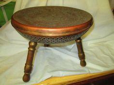Vintage Foot Warming Brass Stool 3 legs Ornate by HankiePanky $100 12 in tall and 14 diameter.Can be found in Mass. area on Craigslist for around $40.