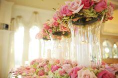 Pink and green floral altar vases