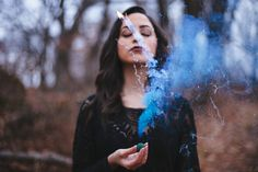 Marieli De Jesus and our friend blue the color smoke bomb  Denisse Benitez Photography