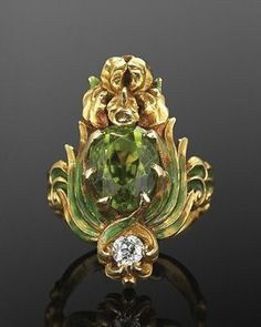 An Art Nouveau green enamel, peridot and diamond ring, by Marcus & Co.,  circa An yellow gold iris flower is painted with green enamel leaves  centring an ...