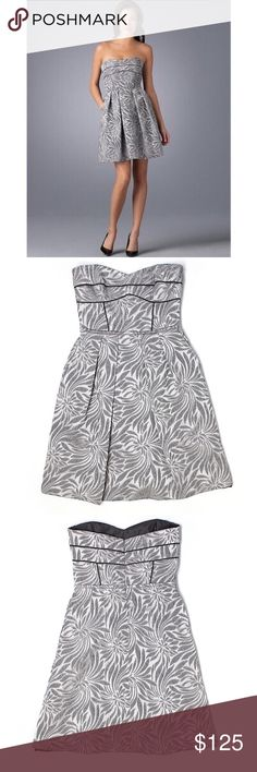 """NWOT Cynthia Steffe Strapless Floral Print Dress Gray dress with different shades of gray and the dark gray trim. Stock photos is the  same dress in a different color to show fit. Waist 13.5"""" across, length 30"""". Pockets! Has a built in corset-like too for a good fit. 85% poly 15% acrylic. Offers welcome through offer tab. No trades. 10216171131 Cynthia Steffe Dresses Strapless"""