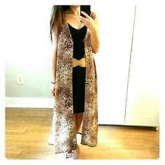 Fierce Long vest from Japan! Amazing piece from Japan. I am huge fan of long vests. Really elongates the body. 100% polyester so it is cool for spring. Perfect condition. As I type this I am thinking I am crazy to let go of this! Jackets & Coats Vests
