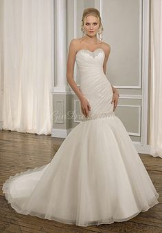 It's becoming clear that I like mermaid, organza, tulle, rouching, strapless....the perfect dress is emerging!  Now to hit the gym!!