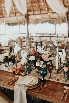 A dreamy rustic boho wedding reception set-up that you could easily replicate with your wedding venue. Just see the flowers and linen's simple and elegant.    Photo by Melissa Marshall, event planning by Diana Romo, floral design by Maria Limon