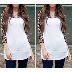 NWOT Animal Top with 3/4 sleeve in leopard print Gorgeous leopard 3/4 sleeves blouse. Says XL, but is cut small, so will fit a Medium. *PRICE IS FIRM* Tops Tees - Long Sleeve