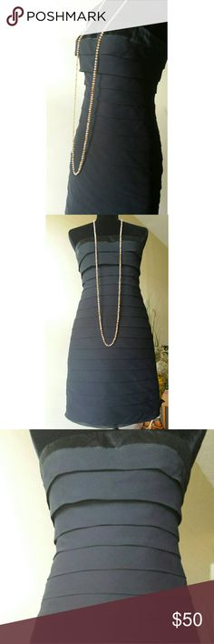⬇Express⬇ Cocktail Dress Black strapless dress with sheer layering from top to bottom with hidden zipper in the back, top had a thin satin strip around the top. The inside does not have any tags dress is in EXCELLENT  CONDITION. This is a beautiful dress for special occasion and events... Express Dresses
