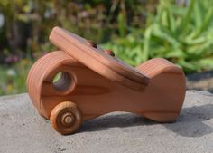 """Our wood toys are hand crafted one at a time in our shop. These toys are made in a simple, safe, durable, and classical design to encourage imagination and creativity in children. Most of our toys are made from redwood grown in the Sierra Nevada Mountains and the Coastal Range in California. We use AFM Safecoat Naturals, a natural vegetable oil and wax finish. Measurements: 6.25"""" long, 3.5"""" high, 6"""" wide Little Boy Toys, Toys For Boys, Wood Crafts, Diy Crafts, Handmade Wooden Toys, Wooden Car, Pull Toy, Wood Toys, Classic Toys"""