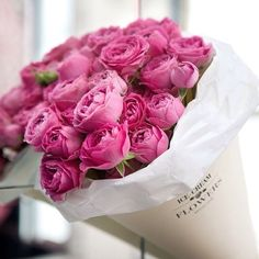 Flowers in a box. Pink roses.