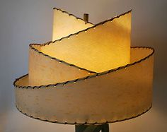 What a neat lamp shade on EBay right now.....under a hundred, but has four more days