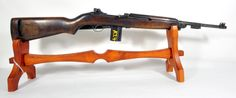 """Quality Hardware M1 Carbine .30 Cal 18"""". This example was made by Quality Hardware, with a barrel made by Underwood. The serial # on the rear of the receiver is 1611XXX, which should point to manufacture in 1943, and the barrel stamps support this as well, with '7 - 43' indicating production in July of that year. The barrel also bears a 'flaming bomb' stamp. Features a rear adjustable sight, marked with 'P1' & front blade sight, low wood stock, and flip safety. $599.99"""