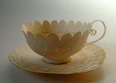 Cecilia Levy — #4 Intet är som väntans tider/ Nothing is like expecting, 2012. Cup 9 cm ø, saucer 13 cm ø. Book pages and glue.
