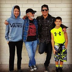 Slash with his dad Tony, London and Cash.