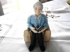 Granny on a comfy armchair. Both the armchair and figurine are handmade with polymer clay
