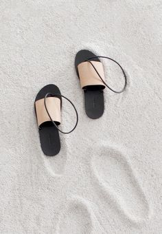 I'm not usually someone who covets shoes, let alone sandals, but when I saw these in NYT Sunday Styles section I couldn't help but become obsessed. They are like modern art for your feet in such a lovely, simple way.