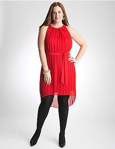 Pleated chiffon dress makes a head-turning entrance with a trendy high-low hem. Perfect any time of year with its sleeveless design and lightweight construction. Sheer chiffon is fully lined for modesty and a graceful drape, coming together with a matching tie belt for a flattering shape. You've never felt so gorgeous! lanebryant.com