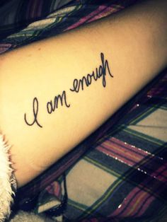 Tattoo reads: I am enough