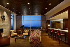 Rich wood ceilings and plush furnishings accent the new piano bar. Photo: Casey Dunn.