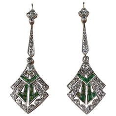 Art Deco Emerald Diamond Platinum Earrings. Diamond and emerald drop earrings set in platinum dated circa 1920 with original fitted box. c1920