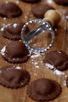 chocolate ravioli:        2 1/2 cups all purpose flour      1/3 cup unsweetened cocoa powder      4 eggs - divided      1/3 - 1/2 cup water      8 ounces mascarpone      4 tablespoons sugar - divided      1 teaspoon pure vanilla extract      1 tablespoon roughly chopped fresh mint