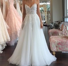 This dress AND THE PINK ONE IN THE BACK !!!!
