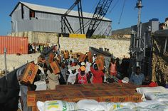 Citizens unload relief supplies in Gonaives, Haiti, from landing craft utility embarked on USS Kearsarge (U.S. Navy/Joshua Adam Nuzzo)