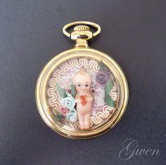 Poupée d Artiste Kewpie miniature Biscuit Montre à Gousset Marie Osmond 1980