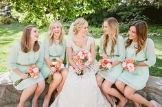 Mint Bridesmaid dresses with coral color flowers. Love!  #mint #mintweddingideas #bridesmaiddresses http://www.thebridelink.com/blog/2013/04/15/mint-and-peach-wedding-ideas-for-bridesmaids/