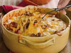 Home-style ground beef Casserole    This is a flavorful casserole, made with ground beef, Cheddar cheese, seasoned veggies, cream cheese, sour cream, and egg noodles.