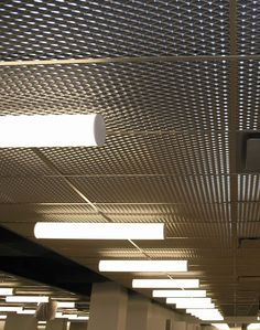 Metal ceiling panels...love this look. Plus, it's sustainable! :)