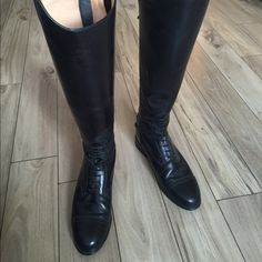 Ariat tall riding boots Black riding boots (the real deal) made by Ariat. Size 8.5 tall and regular calf. Amazing condition and worn only a few times. Well made real leather. Style 53001. Ariat Shoes