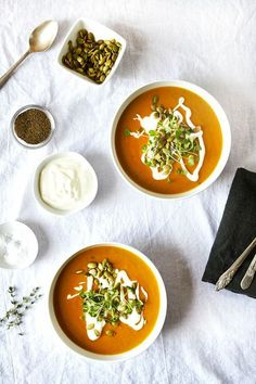 Creamy Coconut Pumpkin Soup with Toasted Pepitas and Creme Fraiche