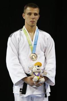 July 12 - Judo - Men's - 73 kg.  Canada's Arthur Margelidon wears his bronze medal earned during in the men's -73kg judo division at the Pan Am Games, Sunday, July 12, 2015, in Mississauga, Ontario. (AP Photo/Julio Cortez)