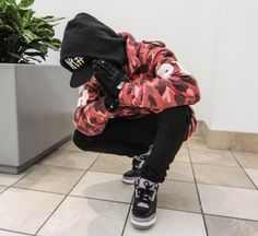 """A Bathing Ape pink camouflage jacket with hood. Swagger black trill hat and black pants. Nike printed black and white shoes.     Isn't this cool? Let me know you what you think.     #pinkcamo #streetwear     """"Brought to you by Upscale Streetwear Shop: StreetwearHub"""""""
