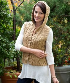 Knit Hooded Cable Vest  This would look so perfect over all my long sleeved shirts for fall! #knitvest