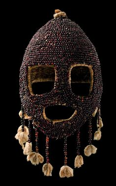 Africa   Mask from the Koro people of Nigeria   Plaited plant fibre netting, embroidered with abrus beans