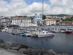 "The harbor in Horta, Azores.  I have so many fond memories of this place.  The black rocks in the foreground are, on their harbor face, covered with sailor's graffiti.  My fave was always ""The liver is Evil, it Must be Punished."""