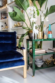 """A comfy yet stylish arm chair with luxurious navy velvet cushions. Available in chrome or brass finish. - Dimensions: 32""""H x 30""""W x 31""""D - Materials: Metal; Velvet - Finish: Brass; Navy This item typi"""