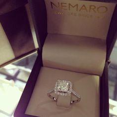 Diamond engagement ring with princess cut diamond and square halo setting