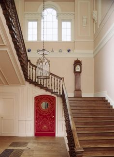 The Staircase Hall at Uppark, another example of Paine's compact, top-lit staircases. The red baize door leads to the servants' quarters. ©NTPL/Geoffrey Frosh