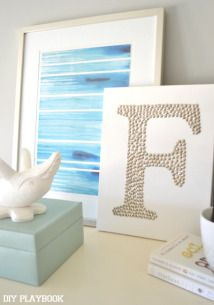 Monogrammed art using metallic thumb tacks by @DIY Playbook