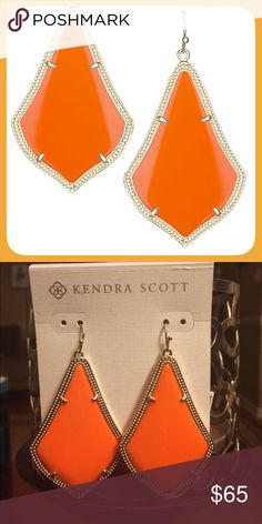 "NWT Kendra Scott Alexandra Earrings in Orange Brand NWT.  Excellent condition. Never worn.  These Kendra Scott Alexandra's are the perfect addition going into the summer!!  A bright orange hue to liven your everyday style, these statement earrings give a vibrant pop that suits any occasion.  Comes with dust bag and care card.  No trades. No PayPal. 💕 PRODUCT DETAILS • 14K Gold Plated Over Brass • Size: 2""L x 1.36""W on earwire • Material: bright orange opaque glass Kendra Scott Jewelry…"
