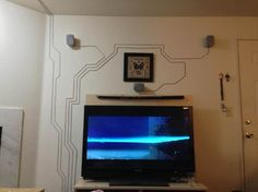 Practical and stylish way to place speaker wire.