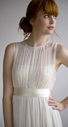 opaque strapless silk lining is enveloped in sheer ivory silk chiffon gathered at a sleeveless crew neck while a generous skirt and sweeping train fall to the floor.