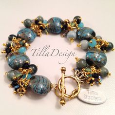 Lovely bracelet with lampwork, stones, czhech crystal and chinese crystal from TillaDesign.