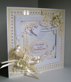 Wedding Card using dies from Spellbinders Grand Squares and Heirloom Oval, Tonic Layering Squares, Memory Box Heart Swoosh, Nellie Snellen Ovals, Creative Expressions / Sue Wilson, Ivy and Scored Lines Embossing Folder, Flowers from Wild Orchid Crafts, Centura Pearl Card from Crafters Companion and Cream Card from Papermilldirect.