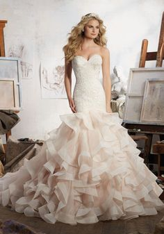 Wedding Dresses and Bridal Gowns by Morilee Designed by Madeline Gardner. Stunning Mermaid Net and Organza Wedding Dress with allover Embroidery.