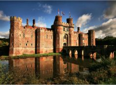 Herstmonceux Castle is a brick-built Tudor castle near Herstmonceux, East Sussex, England. From 1957 to 1988 its grounds were the home of the Royal Greenwich Observatory. Beautiful Castles, World's Most Beautiful, Beautiful Places, Uk Holidays, Famous Castles, Medieval Castle, East Sussex, Kirchen, Far Away