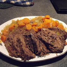 """Kate's Easy German Sauerbraten   """"This is a slow-cooker version of a classic German recipe. Sauerbraten is often served with red cabbage and spaetzle noodles."""""""