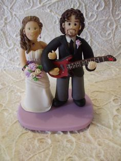 Customized bride and groom with guitar wedding by Abracadabrakr