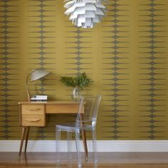 Retro 1950s Mustard Wallpaper | i love retro | This retro inspired wallpaper has a subtle mid century pattern that works to complete a whole room. Finished off with brown tones and bold mustard yellow.